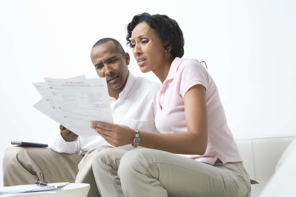 Young couple reviewing roof repair and replacement insurance claims